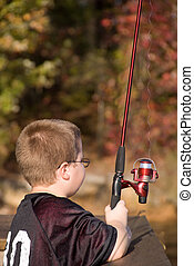 Fishing Boy - A boy fishing at a lake on a warm autumn day.