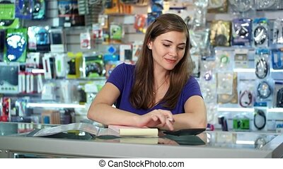 Shop Owner Checking Bills - Young white female entrepreneur...