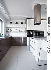 Wooden cupboards in modern kitchen - Picture of wooden...