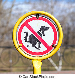 Signpost no Dog Poop - A sign in a park for no poop with the...
