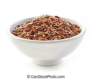 bowl of flax seeds isolated on white