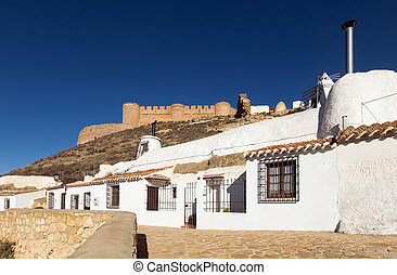 Dwelling houses built into mount Chinchilla de Monte-Aragon,...