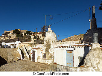 Dwellings houses-caves built into rock Chinchilla de...