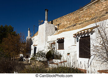 Dwellings aves built into mount. Chinchilla de Monte-Aragon,...
