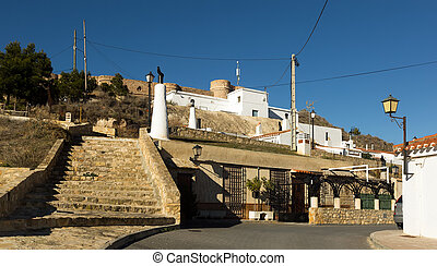 District with houses-caves built into mount. Chinchilla -...