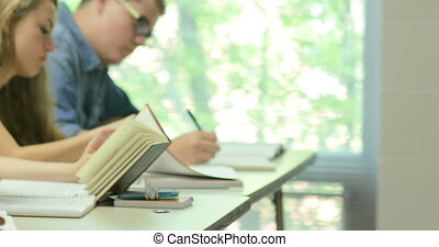 Students taking notes and doing the