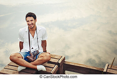 handsome young stylish men with vintage camera chill out by...