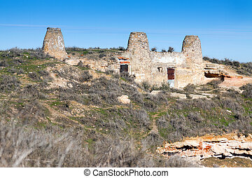 Chimneys of dwelling houses built into mount. Chinchilla de...