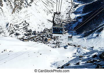 Cablecar to Val dIsere, Alps in winter, Tarentaise, France