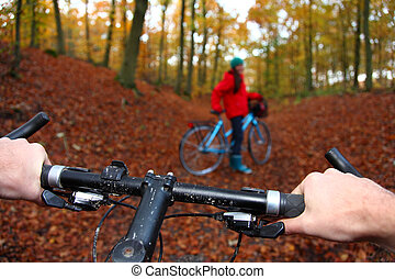 Biking - Mountain bike. Biking in the forest, from cyclist...