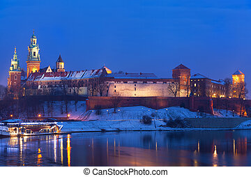 Wawel castle in night illumination in the winter. Krakow,...