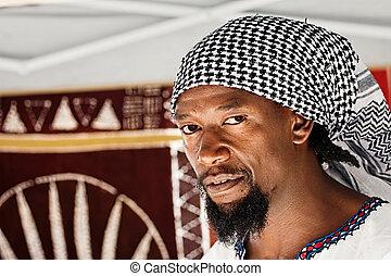 Rastafarian - portrait of young rasta man in the craft...