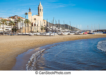 Church and beach in Sitges - The church and the beach in...