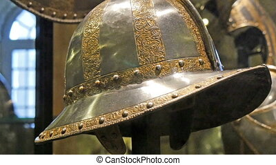 A metal knights hat in the Tower of London It is hanged on...