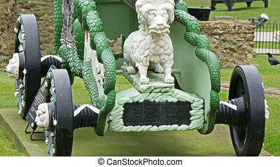 One big green cannon displayed in the Tower of London. It...