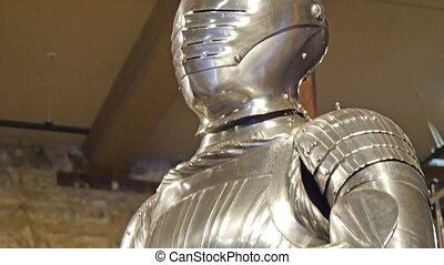 A knight in metal suit statue