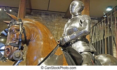 A statue of a man in a horse inside the tower of London It...