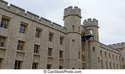 Glimpse of the whole Tower of London. It is in white/brown...