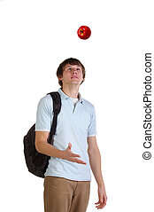 Young student throw up red apple. Studio shot