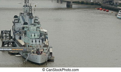 The Belfast warship with some people on it. They are some...