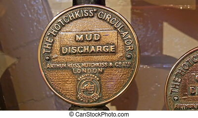 Circle bronze medal indicating some company names on it...