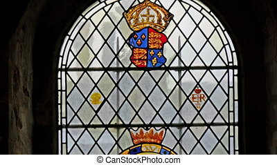 The stained glass window of the chapel inside the tower...