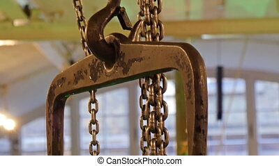 A bronze colored chain carrying heavy metal. The chain is...