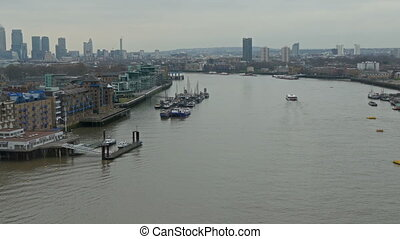 Bird view of the Thames river wit lots of buildings on the...