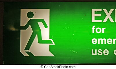 A signage saying Exit for emergency use only. It is a green...