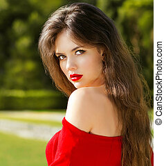Outdoors portrait of attractive sensual girl in red with...