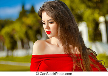 Beautiful young girl Outdoor portrait. Attractive Woman with red
