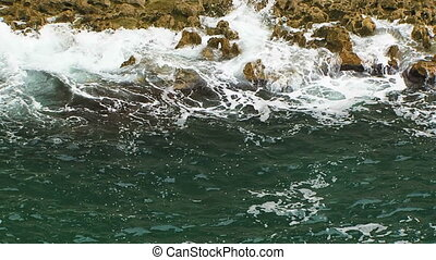 Calm Waves Gently Washing Rocks - Two frames: slow motion...