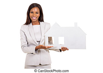 african busineswoman showing house symbol - cheerful african...