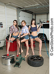 Three girls for tire. car repair - Three sexy girls for...