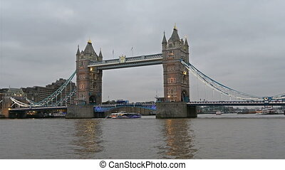 The Tower Bridge with lights on early evening