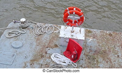 A floating object with safety gears in orange. There are...