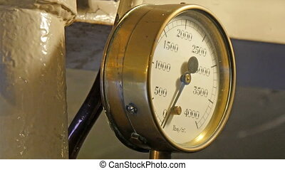 A weighing meter measuring pounds. It is a weighing scale...