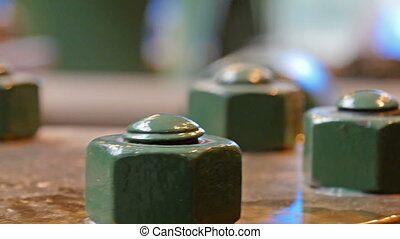Green screws on a hydraulic cylidner