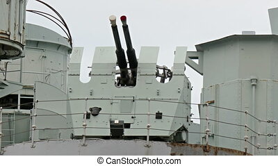 Two artillery guns in the warship
