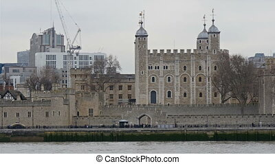 The tall architectural buildings alongside Thames river With...