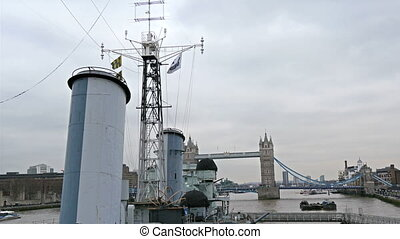 Three big tubes on top of the warship Belfast. The warship...
