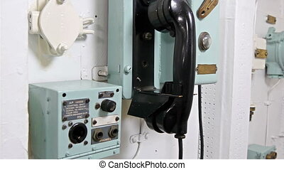 The black telephone and the mic in the warship. It is used...