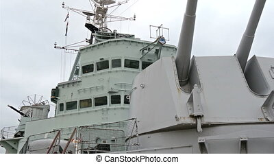 The very large part of the Belfast warship. White warship...