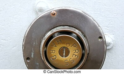 A button that says press hard It is brown in color with the...