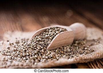 Some Hemp Seeds (close-up shot) on wooden background