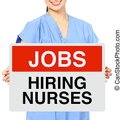 We Need Nurses - A medical person holding a recruitment sign...