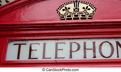 A red telephone booth found on the streetside in London The...
