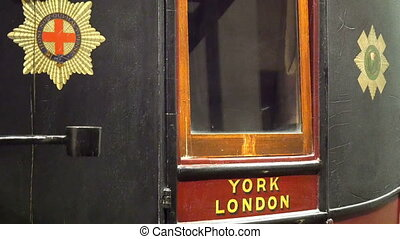 The side view of the vintage royal mail carriage. This...