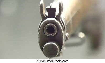 Closer look of the front of a shot gun and the hole infront...