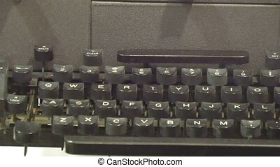 An old black model of a typewriter. With the big black keys...